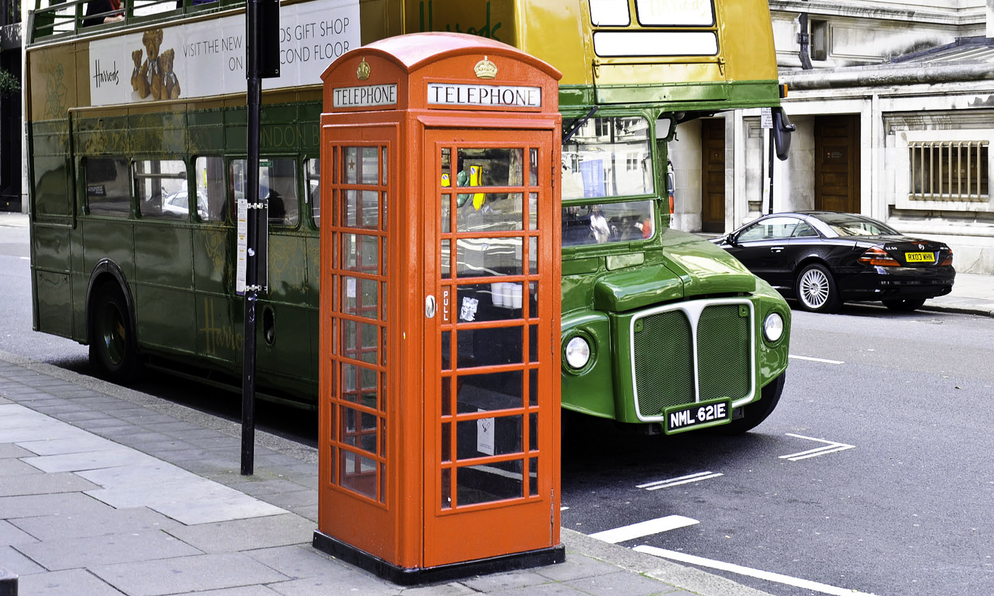 Photo of red phone box on street in London.